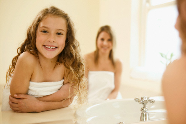 Young Girl in Bathroom with Mother